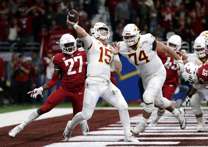 Iowa State quarterback Brock Purdy (15) is pressured by Washington State defender Willie Taylor III (27) as he throws a pass during the the first half of the Alamo Bowl NCAA college football game Friday, Dec. 28, 2018, in San Antonio. (AP Photo/Eric Gay)