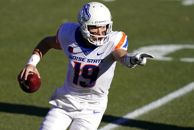FILE - In this Dec. 19, 2020, file photo, Boise State quarterback Hank Bachmeier (19) directs his team during an NCAA college football game for the Mountain West championship  against San Jose State in Las Vegas. Bachmeier and Jack Sears appear perfectly capable of being the starter for the Broncos this season. (AP Photo/John Locher, File)