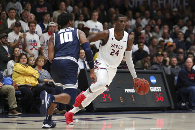 Saint Mary's forward Malik Fitts (24) drives against Utah State forward Alphonso Anderson (10) during the first half of an NCAA college basketball game in Moraga, Calif., Friday, Nov. 29, 2019. (AP Photo/Jed Jacobsohn)