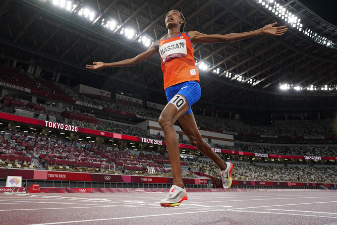 Sifan Hassan, of the Netherlands, celebrates as she crosses the finish line to win the women's 5,000-meters final at the 2020 Summer Olympics, Monday, Aug. 2, 2021, in Tokyo. (AP Photo/David J. Phillip)