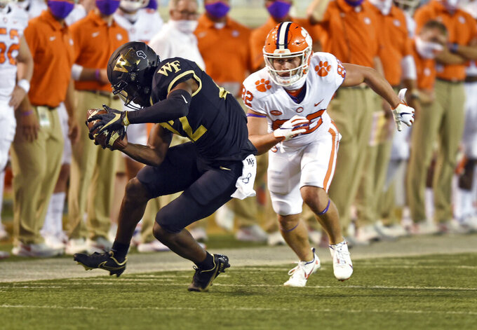 Wake Forest's A.J. Williams picks off a pass intended for Clemson's Will Brown during the second half of an NCAA college football game Saturday, Sept. 12, 2020, in Winston-Salem, N.C. (Walt Unks/The Winston-Salem Journal via AP)