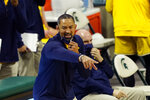 Michigan head coach Juwan Howard yells from the sideline during the first half of an NCAA college basketball game against Michigan State, Sunday, March 7, 2021, in East Lansing, Mich. (AP Photo/Carlos Osorio)