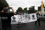Anti-racism groups hold a banner during a