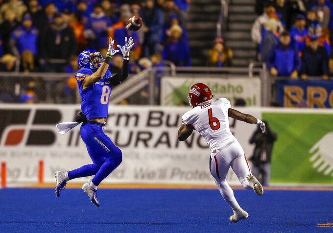 Boise State wide receiver Sean Modster (8) reaches back for the ball on a reception in front of Fresno State defensive back Anthoula Kelly (6) during the first half of an NCAA college football game Friday, Nov. 9, 2018, in Boise, Idaho. (AP Photo/Steve Conner)