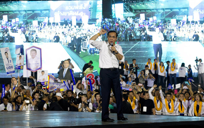 Thai Prime Minister Prayuth Chan-ocha of the Palang Pracharat Party delivers a speech to supporters, during an election campaign rally in Bangkok, Thailand, Friday, March 22, 2019. The political movement that has won every Thai election in nearly two decades is facing its biggest test yet: Squaring off against the allies of the military junta that removed it from power and rewrote the electoral rules with the goal of putting an end to those victories. (AP Photo/Sakchai Lalit)