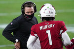 Arizona Cardinals head coach Kliff Kingsbury talks with quarterback Kyler Murray (1) during the second half of an NFL football game against the Philadelphia Eagles, Sunday, Dec. 20, 2020, in Glendale, Ariz. (AP Photo/Ross D. Franklin)