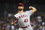 Los Angeles Angels pitcher Patrick Sandoval throws against the Arizona Diamondbacks in the first inning during a baseball game, Sunday, June 13, 2021, in Phoenix. (AP Photo/Rick Scuteri)