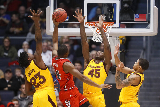 St. John's Mustapha Heron (14) shoots against Arizona State's Romello White (23) and Zylan Cheatham (45) during the first half of a First Four game of the NCAA men's college basketball tournament Wednesday, March 20, 2019, in Dayton, Ohio. (AP Photo/John Minchillo)