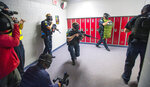 FILE - In this June 9, 2017, file photo, members of the Fountain Police Department take part in Active Shooter Response Training exercise at Fountain Middle School in Fountain, Colo. Twenty years after the Columbine High School shooting made practicing for armed intruders as routine as fire drills, many parents have only tepid confidence in the ability of schools to stop a gunman, according to a new poll by The Associated Press-NORC Center for Public Affairs Research. (Dougal Brownlie/The Gazette via AP, File)