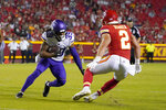 Minnesota Vikings cornerback Parry Nickerson (39) returns an interception for a touchdown as Kansas City Chiefs wide receiver Dalton Schoen (2) defends during the second half of an NFL football game Friday, Aug. 27, 2021, in Kansas City, Mo. (AP Photo/Ed Zurga)