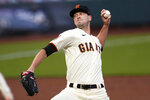 San Francisco Giants' Drew Smyly pitches against the Seattle Mariners during the first inning of a baseball game in San Francisco, Wednesday, Sept. 16, 2020, in a makeup of a game postponed Tuesday in Seattle. (AP Photo/Jeff Chiu)