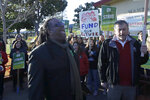 Oakland Education Association President Keith Brown, center left, yells after speaking outside of Manzanita Community School in Oakland, Calif., Thursday, Feb. 21, 2019. Teachers in Oakland, California, went on strike Thursday in the country's latest walkout by educators over classroom conditions and pay. (AP Photo/Jeff Chiu)