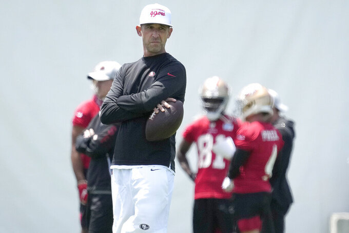 San Francisco 49ers head coach Kyle Shanahan watches a drill NFL football rookie minicamp in Santa Clara, Calif., Friday, May 14, 2021. (AP Photo/Tony Avelar)