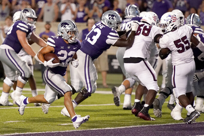 Kansas State running back Deuce Vaughn (22) runs into the end zone to score a touchdown during the second half of an NCAA college football game against Southern Illinois, Saturday, Sept. 11, 2021, in Manhattan, Kan. Kansas State won 31-23 (AP Photo/Charlie Riedel)