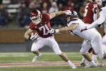 FILE - In this Nov. 17, 2018, file photo, Washington State running back Max Borghi (21) runs while under pressure from Arizona linebacker Colin Schooler during the first half of an NCAA college football game in Pullman, Wash. The departure of James