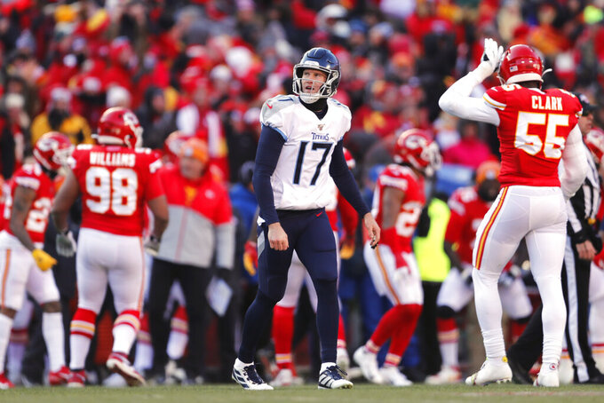 Tennessee Titans' Ryan Tannehill (17) watches the scoreboard after an incomplete pass during the first half of the NFL AFC Championship football game against the Kansas City Chiefs Sunday, Jan. 19, 2020, in Kansas City, MO. (AP Photo/Jeff Roberson)