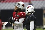 Arizona Cardinals wide receiver Larry Fitzgerald (11) talks with a coach and Cardinals quarterback Kyler Murray (1) during NFL football training camp Wednesday, July 31, 2019, in Glendale, Ariz. (AP Photo/Ross D. Franklin)
