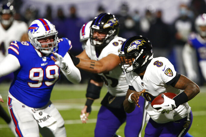 Baltimore Ravens quarterback Lamar Jackson (8) rushes during the first half of an NFL divisional round football game against the Buffalo Bills Saturday, Jan. 16, 2021, in Orchard Park, N.Y. (AP Photo/John Munson)