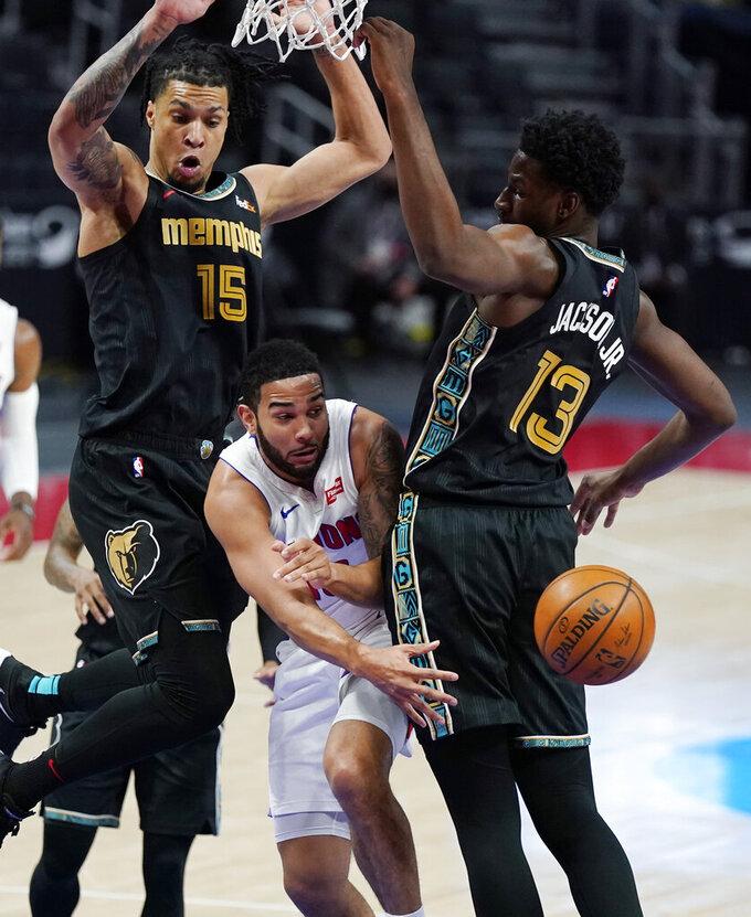 Detroit Pistons guard Cory Joseph passes as Memphis Grizzlies forward Brandon Clarke (15) and forward Jaren Jackson Jr. (13) defend during the first half of an NBA basketball game, Thursday, May 6, 2021, in Detroit. (AP Photo/Carlos Osorio)