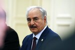 Libyan Gen. Khalifa Hifter joins a meeting with the Greek Foreign Minister Nikos Dendias and other officials in Athens, Friday, Jan. 17, 2020. The commander of anti-government forces in war-torn Libya has begun meetings in Athens in a bid to counter Turkey's support for his opponents. (AP Photo/Thanassis Stavrakis)