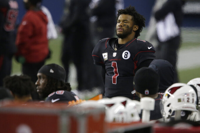 Arizona Cardinals quarterback Kyler Murray (1) watches from the sideline during the second half of an NFL football game against the Seattle Seahawks, Thursday, Nov. 19, 2020, in Seattle. (AP Photo/Lindsey Wasson)