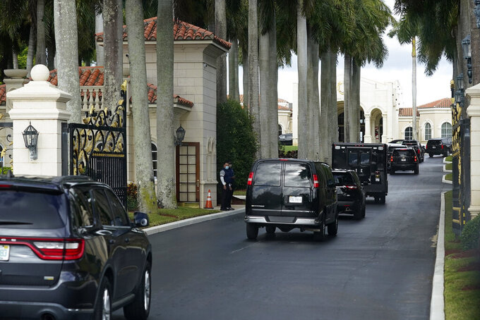 President Donald Trump's motorcade arrives at Trump International Golf Club, Thursday, Dec. 24, 2020, in West Palm Beach, Fla. (AP Photo/Patrick Semansky)