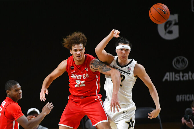 Radford center Lewis Djonkam (22) blocks out Vanderbilt forward Quentin Millora-Brown, right, during the first half of an NCAA college basketball game Saturday, Dec. 19, 2020, in Nashville, Tenn. Vanderbilt won 59-50. (AP Photo/John Amis)