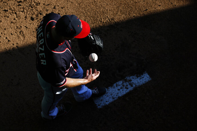 Washington Nationals starting pitcher Max Scherzer warms up in the bullpen before the team's baseball game against the Arizona Diamondbacks, Friday, June 14, 2019, in Washington. (AP Photo/Patrick Semansky)