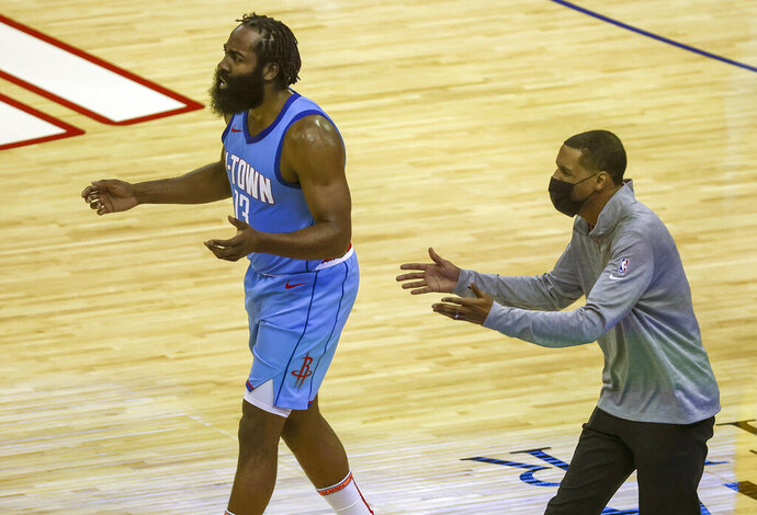 Houston Rockets guard James Harden (13) and coach Stephen Silas, right, react after a play during the second quarter against the Los Angeles Lakers in an NBA basketball game Tuesday, Jan. 21, 2021, in Houston. (Troy Taormina/Pool Photo via AP)