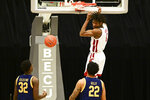 Washington State center Efe Abogidi (0) dunks as California guard Jalen Celestine (32) and forward Andre Kelly (22) watch during the first half of an NCAA college basketball game Thursday, Feb. 18, 2021, in Pullman, Wash. (AP Photo/Pete Caster)