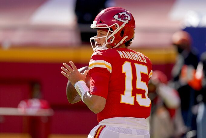 Kansas City Chiefs quarterback Patrick Mahomes (15) drops back to make a pass in the first half of an NFL football game against the New York Jets on Sunday, Nov. 1, 2020, in Kansas City, Mo. (AP Photo/Charlie Riedel)