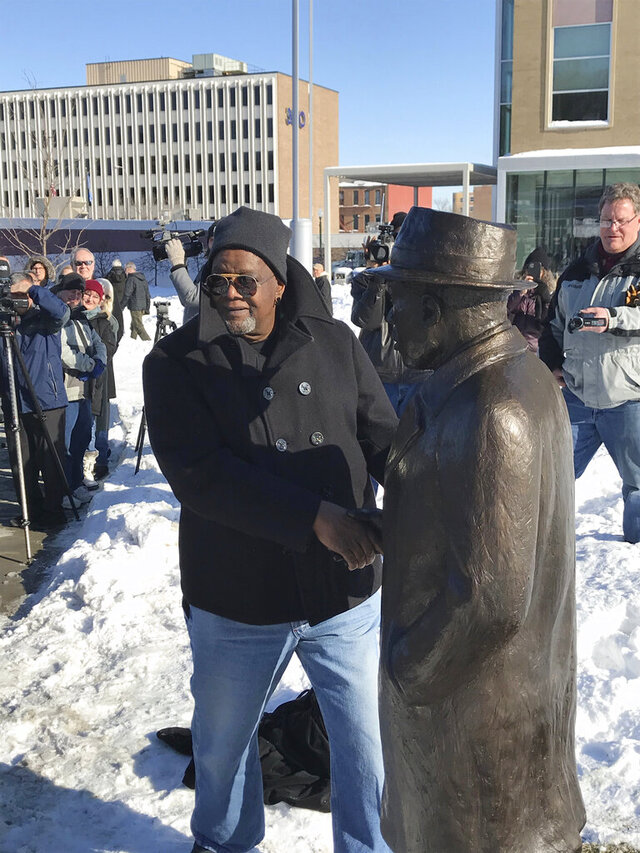 In this Monday, Jan. 20, 2020, photo, sculptor Porter Williams shows the statue of Martin Luther King Jr. that he made at Van Eps Park, nearly 60 years after King visited Sioux Falls, S.D. The Baptist minister from Atlanta was already a well-known civil rights leader who advocated non-violent protests when he arrived in Sioux Falls. He turned 32 just three days after visiting Sioux Falls. (Jonathan Ellis/The Argus Leader via AP)