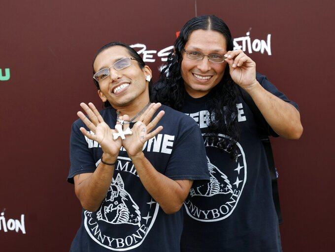"""Cast members Funny Bone and Lil Mike attend the premiere of the new series """"Reservation Dogs,"""" at Circle Cinema in Tulsa, Okla., on Monday, Aug. 2, 2021. (John Clanton/Tulsa World via AP)"""