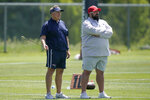 New England Patriots head coach Bill Belichick, left, and coach Matt Patricia, right, stand together during an NFL football practice, in Foxborough, Mass., Thursday, May 27, 2021. (AP Photo/Steven Senne)