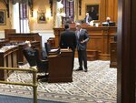 State Sens. Nikki Setzler, left, Shane Massey, center, and Harvey Peeler, right, talk before the Senate's session on Wednesday, Sept. 16, 2020, in Columbia, S.C. The Senate is meeting in a special session this week. (AP Photo / Jeffrey Collins)
