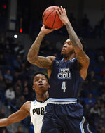 Old Dominion's Ahmad Caver, right, shoots over Purdue's Eric Hunter Jr. during the first half of a first round men's college basketball game in the NCAA tournament, Thursday, March 21, 2019, in Hartford, Conn. (AP Photo/Jessica Hill)