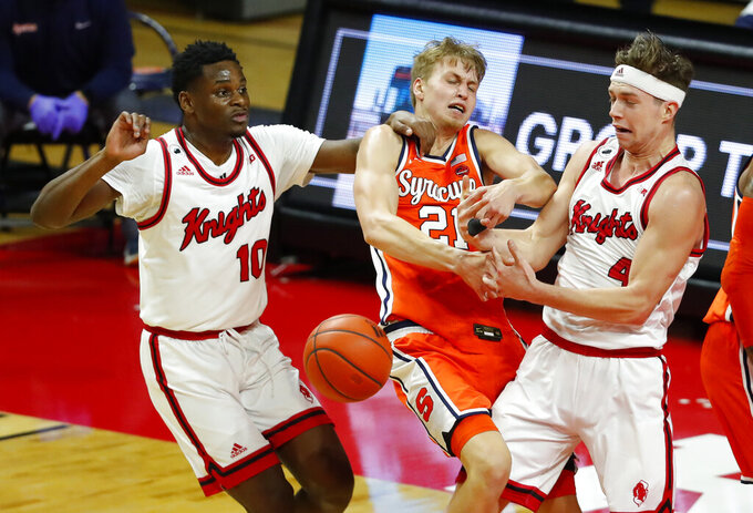 Syracuse forward Marek Dolezaj (21) competes against Rutgers guards Montez Mathis (10) and Paul Mulcahy (4) for the ball during the second half of an NCAA college basketball game in Piscataway, N.J., Tuesday, Dec. 8, 2020. (AP Photo/Noah K. Murray)