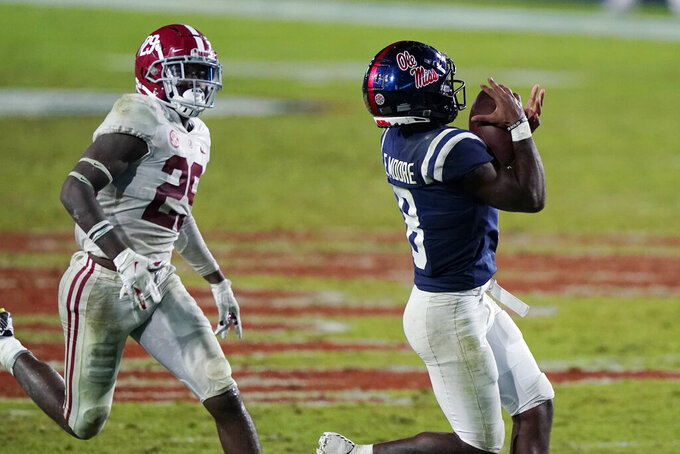 Mississippi wide receiver Elijah Moore (8) catches a pass in front of Alabama defensive back DeMarcco Hellams (29) during the second half of an NCAA college football game in Oxford, Miss., Saturday, Oct. 10, 2020. Alabama won 63-48. (AP Photo/Rogelio V. Solis)
