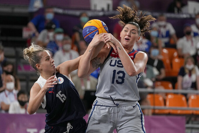 United States' Stefanie Dolson (13) and Olga Frolkina (15), of the Russian Olympic Committee, chase a loose ball during a women's 3-on-3 gold medal basketball game at the 2020 Summer Olympics, Wednesday, July 28, 2021, in Tokyo, Japan. (AP Photo/Jeff Roberson)