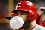 Cincinnati Reds' Eugenio Suarez blows a bubble as he waits to bat against the Arizona Diamondbacks during the third inning of a baseball game, Saturday, Sept. 14, 2019, in Phoenix. (AP Photo/Ross D. Franklin)