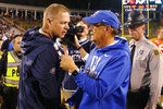 FILE - In this Oct. 19, 2019, file photo, Virginia head coach Bronco Mendenhall, left, talks with Duke head coach David Cutcliffe after an NCAA college football game in Charlottesville, Va. Virginia is finally set to open its season after three prior scheduled openers were scrapped because of the coronavirus pandemic. It's only the second time in David Cutcliffe's 13 years at Duke that the Blue Devils have lost their first two games. (AP Photo/Steve Helber, File)