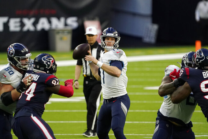 Tennessee Titans quarterback Ryan Tannehill (17) throws a pass against the Houston Texans during the second half of an NFL football game Sunday, Jan. 3, 2021, in Houston. (AP Photo/Sam Craft)