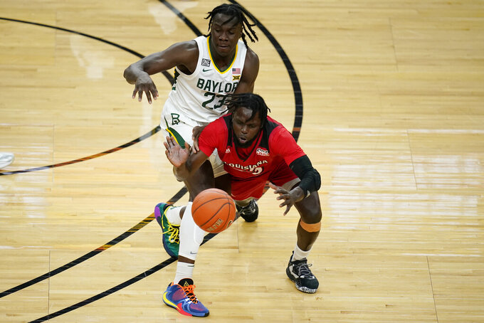 Baylor's Jonathan Tchamwa Tchatchoua, left, and Louisiana-Lafayette's Dou Gueye vie for the ball during the first half of an NCAA college basketball game Saturday, Nov. 28, 2020, in Las Vegas. (AP Photo/John Locher)