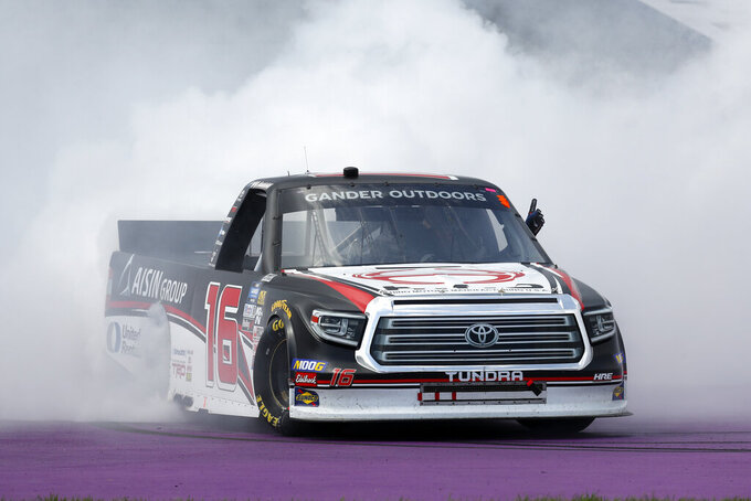 Austin Hill celebrates with a burn out after winning a NASCAR Truck Series race at Michigan International Speedway in Brooklyn, Mich., Saturday, Aug. 10, 2019. (AP Photo/Paul Sancya)