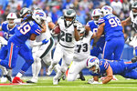 Philadelphia Eagles' Miles Sanders (26), center, breaks through the Buffalo Bills defense to score a touchdown during the second half of an NFL football game, Sunday, Oct. 27, 2019, in Orchard Park, N.Y. (AP Photo/Adrian Kraus)