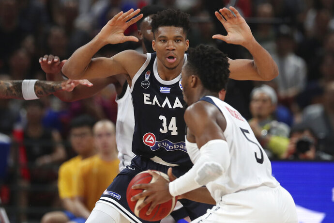 Greece's Giannis Antetokounmpo tries to block United States' Donovan Mitchell during phase two of the FIBA Basketball World Cup at the Shenzhen Bay Sports Center in Shenzhen in southern China's Guangdong province on Saturday, Sept. 7, 2019. United States beat Greece 69-53. (AP Photo/Ng Han Guan)