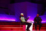 Kehinde Wiley, right, and Swizz Beatz speak during Art Basel, Monday, Dec. 2, 2019, in Miami Beach, Fla. (AP Photo/Brynn Anderson)