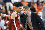 Alabama head coach Nate Oats talks with Alabama guard Jaden Shackelford (5) during the first half of an NCAA college basketball game against Auburn Wednesday, Feb. 12, 2020, in Auburn, Ala. (AP Photo/Julie Bennett)