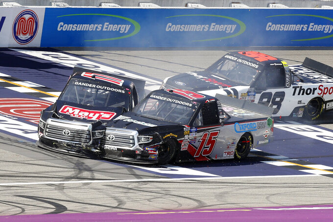 Tyler Ankrum crashes into Anthony Alfredo (15) during a restart in a NASCAR Truck Series race at Michigan International Speedway in Brooklyn, Mich., Saturday, Aug. 10, 2019. (AP Photo/Paul Sancya)