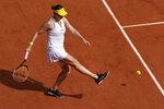 Russia's Anastasia Pavlyuchenkova kicks the ball as she plays Czech Republic's Barbora Krejcikova during their final match of the French Open tennis tournament at the Roland Garros stadium Saturday, June 12, 2021 in Paris. (AP Photo/Christophe Ena)